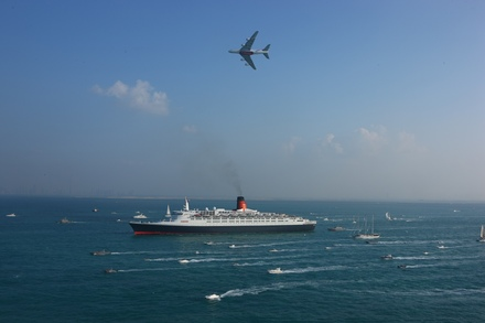 QE2 arrives in Dubai joined by an Emirates A380 Airbus and a flotilla of over 60 local yachts, boats and leisure-craft.JPG