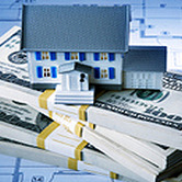 house-on-money-stack-mortgage-home-loan-lending-wpcki.jpg