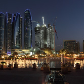 Abu-Dhabi-skyline-at-night-united-arab-emirates-nki.jpg