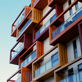Balconies-of-a-modern-luxury-apartments-with-a-blue-sky-nki.jpg