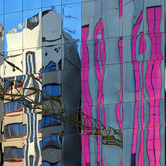 reflection-of-construction-crane-and-apartment-buildings-nki.jpg