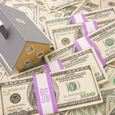 house-on-money-stacks-mortgage-rates-nki.jpg