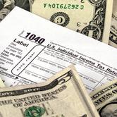 income-tax-return-form-money-dollar-bills-nki.jpg