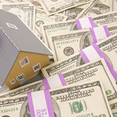house-on-money-stacks-mortgage-rates-keyimage.jpg