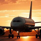 airline-travel-airplane-at-dusk-keyimage.jpg