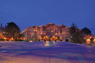 The-Inn-and-Spa-At-Loretto-glows-with-luminarias-at-Christmas.jpg