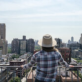 woman-home-buyer-looking-at-real-estate-manhattan-keyimage2.jpg